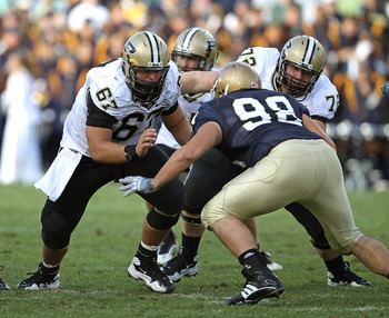 SOUTH BEND, IN - SEPTEMBER 04: Peters Drey #67 and Justin Pierce #72 of the Purdue Boilermakers move to block Sean Cwynar #98 of the Notre Dame Fighting Irish at Notre Dame Stadium on September 4, 2010 in South Bend, Indiana. Notre Dame defeated Purdue 23