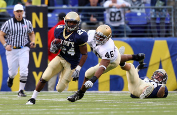 BALTIMORE - NOVEMBER 15:  Corey James #24 of the Navy Midshipmen returns a punt past Steve Filer #46 of the Notre Dame Fighting Irish on November 15, 2008 at M&amp;T Bank Stadium in Baltimore, Maryland. Notre Dame defeated Navy 27-21.  (Photo by Jim McIsaac/G