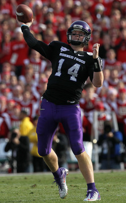 PASADENA, CA - JANUARY 01:  Quarterback Andy Dalton #14 of the TCU Horned Frogs throws a pass against the Wisconsin Badgers in the 97th Rose Bowl game on January 1, 2011 in Pasadena, California.  (Photo by Jeff Gross/Getty Images)