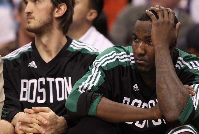 PHOENIX, AZ - JANUARY 28:  Kendrick Perkins #43  of the Boston Celtics reacts while sitting on the bench during the NBA game against the Phoenix Suns at US Airways Center on January 28, 2011 in Phoenix, Arizona. The Suns defeated the Celtics 88-71.  NOTE