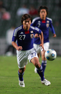 HONG KONG - NOVEMBER 18: Hisato Sato of Japan in action during AFC Asia Cup 2011 Qatar qualifier match between Hong Kong and Japan at Hong Kong Stadium on November 18, 2009 in Hong Kong, Hong Kong. (Photo by Koji Watanabe/Getty Images)