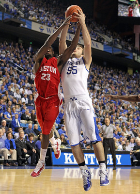 LEXINGTON, KY - NOVEMBER 30:  Josh Harrellson #55 of the Kentucky Wildcats and John Holland #23 of the Boston University Terriers battle for a rebound during the game on November 30, 2010 in Lexington, Kentucky. Kentucky won 91-57.  (Photo by Andy Lyons/G