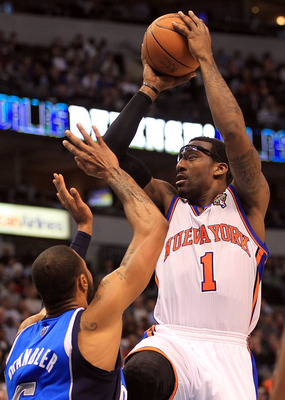 DALLAS, TX - MARCH 10:  Amar'e Stoudemire #1 of the New York Knicks takes a shot against Tyson Chandler #6 of the Dallas Mavericks at American Airlines Center on March 10, 2011 in Dallas, Texas.  NOTE TO USER: User expressly acknowledges and agrees that,