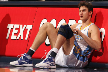 DENVER, CO - FEBRUARY 24:  Danilo Gallinari #8 of the Denver Nuggets adjusts his knee brace as he prepares to reenter the game against the Boston Celtics during NBA action at the Pepsi Center on February 24, 2011 in Denver, Colorado. The Nuggets defeated