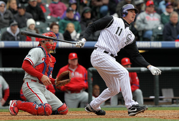 DENVER - MAY 12:  Brad Hawpe #11 of the Colorado Rockies follows through on his two RBI triple to tie the score 3-3 against the Philadelphia Phillies in the seventh inning at Coors Field on May 12, 2010 in Denver, Colorado. The Rockies defeated the Philli