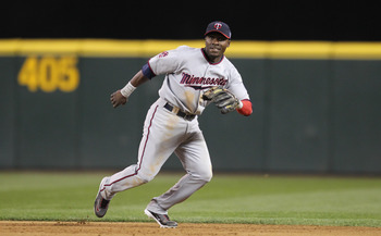 SEATTLE - AUGUST 27:  Second baseman Orlando Hudson #1 of the Minnesota Twins follows the play against the Seattle Mariners at Safeco Field on August 27, 2010 in Seattle, Washington. The Twins won 6-3. (Photo by Otto Greule Jr/Getty Images)