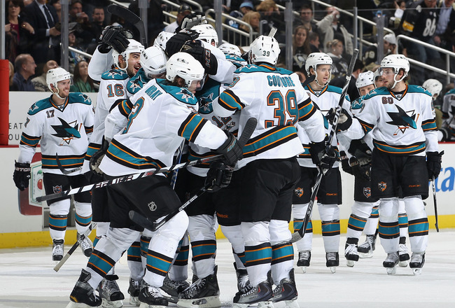 PITTSBURGH, PA - FEBRUARY 23:  The San Jose Sharks celebrate around Patrick Marleau #12 after Marleau scored the game winning goal against the Pittsburgh Penguins during overtime of the NHL game at Consol Energy Center on February 23, 2011 in Pittsburgh,