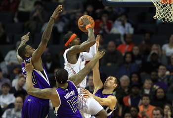 CHARLOTTE, NC - FEBRUARY 25:  Stephen Jackson #1 of the Charlotte Bobcats drives to the basket against teammates Donte Greene #20 DeMarcus Cousins #15 and Beno Udrih #19 of the Sacramento Kings during their game at Time Warner Cable Arena on February 25,