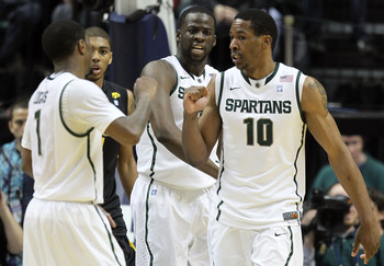 INDIANAPOLIS, IN - MARCH 10:  (L-R) Kalin Lucas #1 , Draymond Green #23 and Delvon Roe #10 of the Michigan State Spartans celebrate a play against the Iowa Hawkeyes during the first round of the 2011 Big Ten Men's Basketball Tournament at Conseco Fieldhou