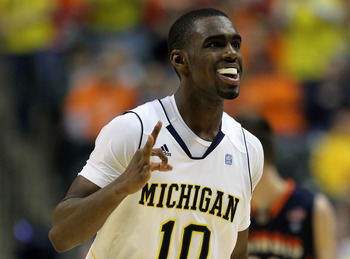 INDIANAPOLIS, IN - MARCH 11:  Tim Hardaway Jr. #10 of the Michigan Wolverines celebrates after he made a 3-point shot in the second half against the Illinois Fighting Illini during the quarterfinals of the 2011 Big Ten Men's Basketball Tournament at Conse