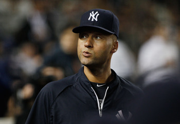 NEW YORK - JUNE 14:  Derek Jeter #2 of the New York Yankees looks on from the bench shortly after being placed on the 15 day disable list during the game against the Texas Rangers on June 14, 2011 at Yankee Stadium in the Bronx borough of New York City.