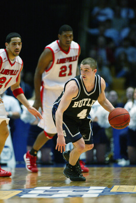 BIRMINGHAM, AL - MARCH 23:  Brandon Miller #4 of Butler drives against Louisville during the NCAA Tournament on March 23, 2003 at the Birmingham Civic Center in Birmingham, Alabama. Butler defeated Louisville 79-71. (Photo by Jamie Squire/Getty Images)