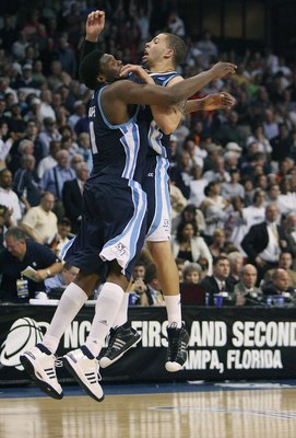 TAMPA, FL - MARCH 21:  Gyno Pomare #21 and Rob Jones #22 of the San Diego Toreros celebrate their team's 70-69 overtime win over the Connecticut Huskies in the first round of the 2008 NCAA Tournament West Regional at the St. Pete Times Forum on March 21,