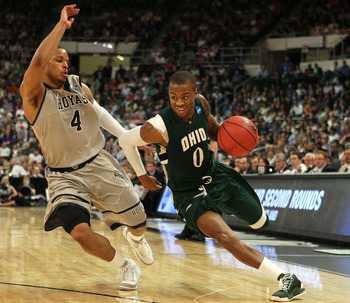 PROVIDENCE, RI - MARCH 18:  Armon Bassett #0 of the Ohio Bobcats drives to the net as Chris Wright #4 of the Georgetown Hoyas defends during the first round of the 2010 NCAA men's basketball tournament on March 18, 2010 at the Dunkin Donuts Arena in Provi