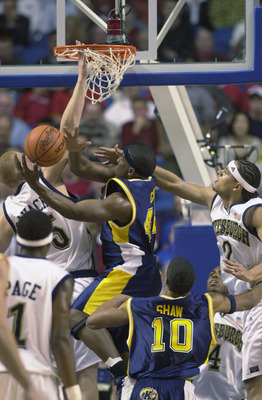 LEXINGTON, KY - MARCH 21:  Antonio Gates #44 of the Kent State Golden Flashes puts up a shot under pressure from Donatas Zavackas #5 and Chevon Troutman #2 of the Pittsburgh Panthers during the Midwest Regional Semifinal during the 2002 NCAA Men's Basketb