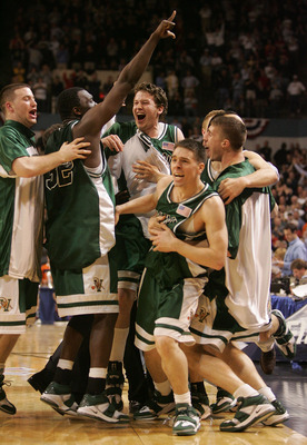 WORCESTER, MA - MARCH 18:  Members of the Vermont Catamounts celebrate after defeating the Syracuse Orange during the first round of the NCAA Men's Basketball Championship at the DCU Center March 18, 2005 in Worcester, Massachusetts.  (Photo By Jim McIsaa
