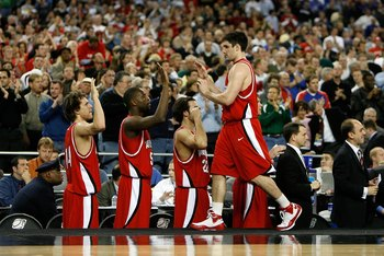DETROIT - MARCH 28:  Jason Richards #2 of the Davidson Wildcats greets his teammates as he checks out of the game late in the second half against the Wisconsin Badgers during the Midwest Regional Semifinal of the 2008 NCAA Division I Men's Basketball Tour