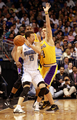 ORLANDO, FL - FEBRUARY 13:  Hedo Turkoglu #15 of the Orlando Magic is guarded by Luke Walton #4 of the Los Angeles Lakers during the game at Amway Arena on February 13, 2011 in Orlando, Florida.  NOTE TO USER: User expressly acknowledges and agrees that,