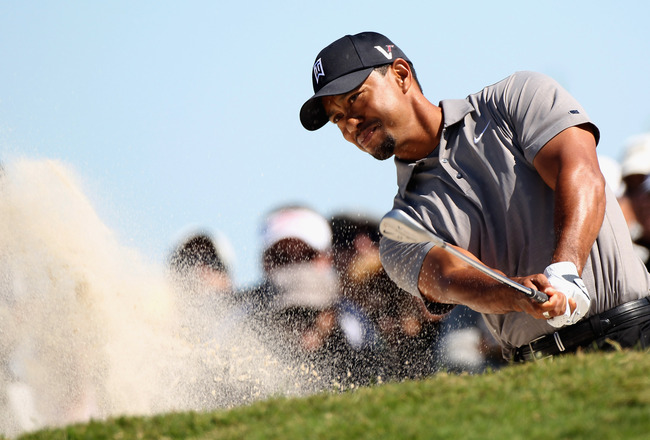 MIAMI, FL - MARCH 11:  Tiger Woods plays a bunker shot on the fourth hole during the second round of the 2011 WGC- Cadillac Championship at the TPC Blue Monster at the Doral Golf Resort and Spa on March 11, 2011 in Doral, Florida.  (Photo by Sam Greenwood