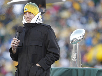 GREEN BAY, WI - FEBRUARY 08:  Green Bay Packers quarterback Aaron Rodgers addresses  the fans at Lambeau Field during the Packers victory ceremony on February 8, 2011 in Green Bay, Wisconsin.  (Photo by Matt Ludtke/Getty Images)