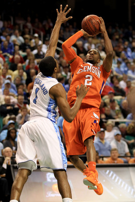 GREENSBORO, NC - MARCH 12:  Demontez Stitt #2 of the Clemson Tigers shoots against Dexter Strickland #1 of the North Carolina Tar Heels in the semifinals of the 2011 ACC men's basketball tournament at the Greensboro Coliseum on March 12, 2011 in Greensbor