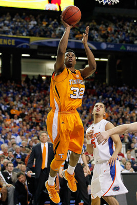 ATLANTA, GA - MARCH 11:  Scotty Hopson #32 of the Tennessee Volunteers shoots over Scottie Wilbekin #5 of the Florida Gators during the quarterfinals of the SEC Men's Basketball Tournament at Georgia Dome on March 11, 2011 in Atlanta, Georgia.  (Photo by