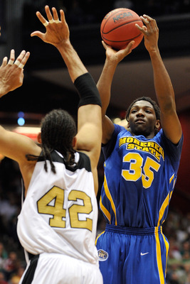 DAYTON, OH - MARCH 17: Kenneth Faried #35 of Morehead State Eagles takes a shot over Chief Kickingstallionsims #42 of the Alabama State Hornets during the opening round of the Men's NCAA Tournament on March 17, 2009 at the University of Dayton Arena in Da