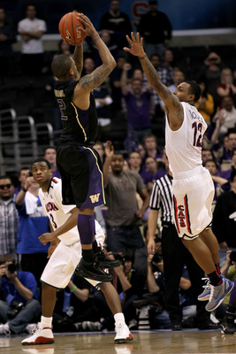 LOS ANGELES, CA - MARCH 12:  Isaiah Thomas #2 of the Washington Huskies makes a last-second shot in overtime over the arm of Lamont Jones #12 of the Arizona Wildcats to lead the Huskies to a 77-75 victory in the championship game of the 2011 Pacific Life