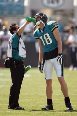 JACKSONVILLE, FL - SEPTEMBER 28:  Matt Jones #18 of the Jacksonville Jaguars is given a drink before the game against the Houston Texans at Jacksonville Municipal Stadium on September 28, 2008 in Jacksonville, Florida.  (Photo by Sam Greenwood/Getty Image