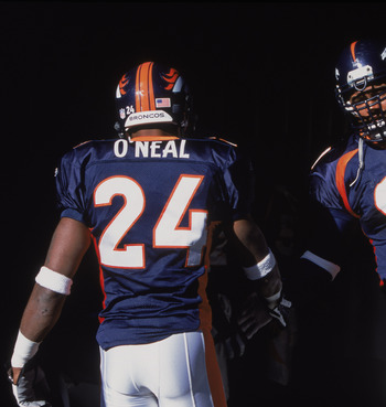 11 Nov 2001:  Defensive Tackle Chester McGlockton #91 of the Denver Broncos shaking the hand of Corner Back Deltha O''Neal #24 before the game against the San Diego Chargers at the Mile High Stadium in Denver, Colorado. The Broncos defeated the Chargers 2