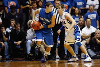 DURHAM, NC - DECEMBER 17:  Greg Paulus #3 of the Duke Blue Devils defends against Matt Dickey #2 of the North Carolina Asheville Bulldogs on December 17, 2008 at Cameron Indoor Stadium in Durham, North Carolina. (Photo by Kevin C. Cox/Getty Images)