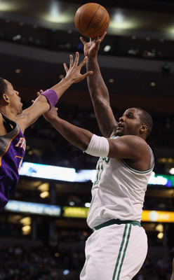 BOSTON, MA - MARCH 02: Glen Davis #11 of the Boston Celtics takes a shot in the first half against the Phoenix Suns on March 2, 2011 at the TD Garden in Boston, Massachusetts.  NOTE TO USER: User expressly acknowledges and agrees that, by downloading and/