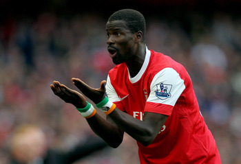 LONDON, ENGLAND - OCTOBER 16:  Emmanuel Eboue of Arsenal protests to the linesman during the Barclays Premier League match between Arsenal and Birmingham City at Emirates Stadium on October 16, 2010 in London, England.  (Photo by Clive Rose/Getty Images)