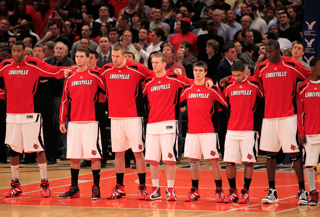 NEW YORK, NY - MARCH 12: The Louisville Cardinals look on during the National Anthem before their game against the Connecticut Huskies during the championship of the 2011 Big East Men's Basketball Tournament presented by American Eagle Outfitters at Madis