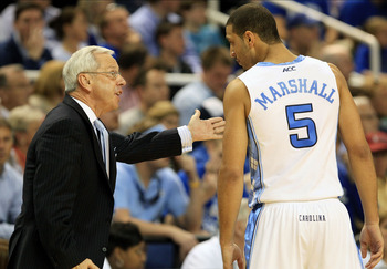GREENSBORO, NC - MARCH 13:  Head coach Roy Williams of the North Carolina Tar Heels talks with Kendall Marshall #5 during the first half against the Duke Blue Devils in the championship game of the 2011 ACC men's basketball tournament at the Greensboro Co