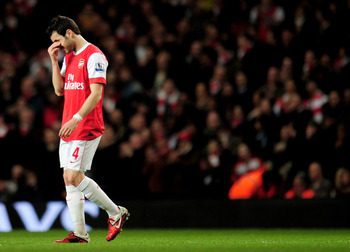 LONDON, ENGLAND - FEBRUARY 23:  Cesc Fabregas of Arsenal looks dejected as he leaves the pitch injured during the Barclays Premier League match between Arsenal and Stoke City at the Emirates Stadium on February 23, 2011 in London, England.  (Photo by Shau