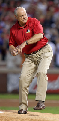 ARLINGTON, TX - OCTOBER 15:  Team President Nolan Ryan of  the Texas Rangers throws out the ceremonial first pitch against the New York Yankees in Game One of the ALCS during the 2010 MLB Playoffs at Rangers Ballpark in Arlington on October 15, 2010 in Ar