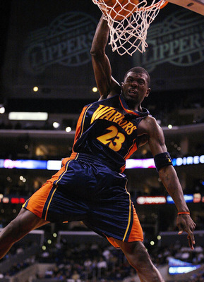 LOS ANGELES - FEBRUARY 26: Jason Richardson #23 of the Golden State Warriors dunks against the Los Angeles Clippers on February 26, 2003 at Staples Center in Los Angeles, California.  NOTE TO USER: User expressly acknowledges and agrees that, by downloadi