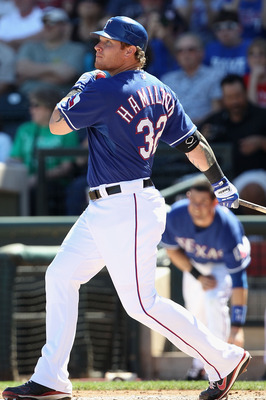 SURPRISE, AZ - MARCH 11:  Josh Hamilton #32 of the Texas Rangers hits a RBI single against the Cincinnati Reds during the first inning of the spring training game at Surprise Stadium on March 11, 2011 in Surprise, Arizona.  (Photo by Christian Petersen/Ge