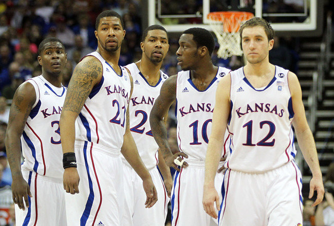KANSAS CITY, MO - MARCH 12:  Josh Selby #32, Markieff Morris #21, Marcus Morris #22,Tyshawn Taylor #10 and Brady Morningstar #12 of the Kansas Jayhawks stand on the court against the Texas Longhorns during the 2011 Phillips 66 Big 12 Men's Basketball Tour