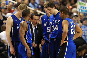 GREENSBORO, NC - MARCH 13:  Head coach Mike Krzyzewski of the Duke Blue Devils talks with players Kyle Singler #12, Nolan Smith #2, Mason Plumlee #5, Ryan Kelly #34 and Andre Dawkins #20 during the first half of the game against the North Carolina Tar Hee