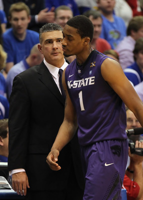 LAWRENCE, KS - JANUARY 29:  Head coach Frank Martin of the Kansas State Wildcats glares at Shane Southwell #1 during the game against the Kansas Jayhawks on January 29, 2011 at Allen Fieldhouse in Lawrence, Kansas.  (Photo by Jamie Squire/Getty Images)