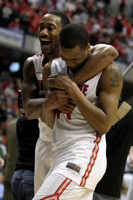 INDIANAPOLIS, IN - MARCH 12:  David Lighty #23 oand William Buford #44 of the Ohio State Buckeyes celebrate after they won 68-61 against the Michigan Wolverines during the semifinals of the 2011 Big Ten Men's Basketball Tournament at Conseco Fieldhouse on