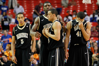 ATLANTA, GA - MARCH 12:  Lance Goulbourne #5, John Jenkins #23, Festus Ezeli #3 and Jeffery Taylor #44 of the Vanderbilt Commodores react after loosing to the Florida Gators 77 to 66 during the semifinals of the SEC Men's Basketball Tournament at Georgia