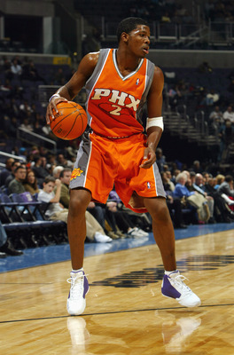 WASHINGTON - JANUARY 30:  Joe Johnson #2 of the Phoenix Suns moves the ball against the Washington Wizards during the game at MCI Center on January 30, 2004 in Washington, D.C.  The Wizards won 105-100.  NOTE TO USER: User expressly acknowledges and agree