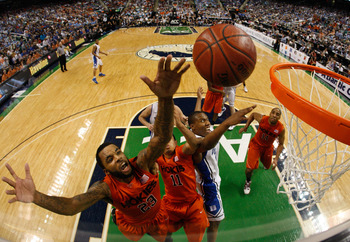 GREENSBORO, NC - MARCH 12:  Malcolm Delaney #23 and Erick Green #11 of the Virginia Tech Hokies battle for a loose ball against Nolan Smith #2 of the Duke Blue Devils in the semifinals of the 2011 ACC men's basketball tournament at the Greensboro Coliseum