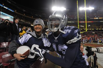 LANDOVER, MD - DECEMBER 27:  Gerald Sensabaugh #43 of the Dallas Cowboys poses with a fan before the game against the Washington Redskins at FedExField on December 27, 2009 in Landover, Maryland. The Cowboys defeated the Redskins 17-0. (Photo by Larry Fre