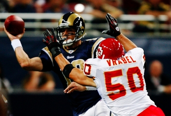 ST. LOUIS, MO - SEPTEMBER 03: Quarterback Kyle Boller #12 of the St. Louis Rams looks to pass over the defense of linebacker Mike Vrabel #50 of the Kansas City Chiefs during the first quarter of the preseason game at the Edward Jones Dome on September 3,
