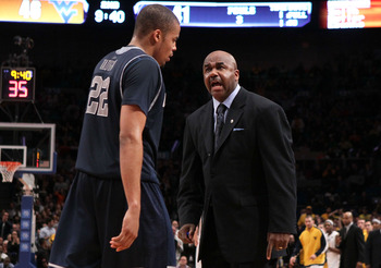 NEW YORK - MARCH 13: Head coach John Thompson III of the Georgetown Hoyas talks to Julian Vaughn #22 during the game against the West Virginia Mountaineers during the championship of the 2010 NCAA Big East Tournament at Madison Square Garden on March 13,