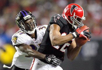 ATLANTA - NOVEMBER 11:  Michael Jenkins #12 of the Atlanta Falcons pulls in this reception against Fabian Washington #31 of the Baltimore Ravens at Georgia Dome on November 11, 2010 in Atlanta, Georgia.  (Photo by Kevin C. Cox/Getty Images)
